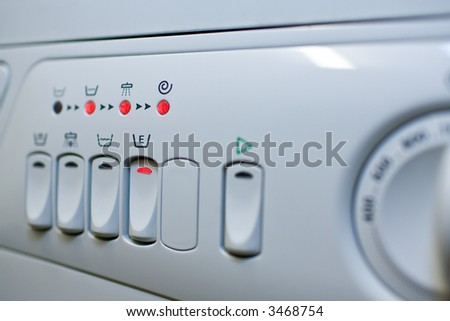 Close-up panel white washing machine. Low DOF. Focus button to set the energy-saving. - stock photo
