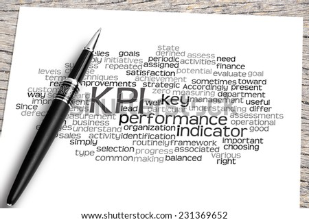 Close Up Pen And Paper On The Wooden Table With Key Performance Indicator (KPI) Word Cloud And Its Related. - stock photo