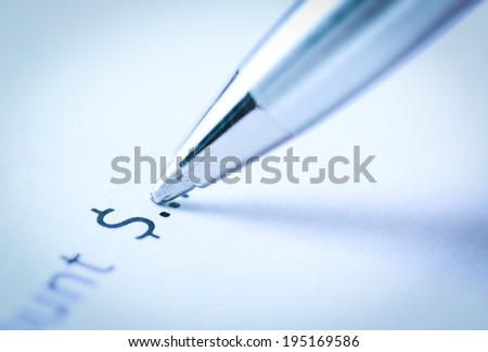 Close up pen writing donation with dollar symbol