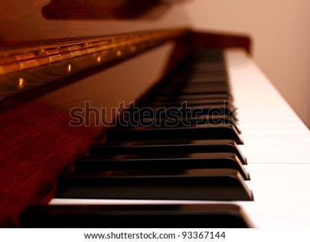 Close up perspective view of a wooden piano - stock photo