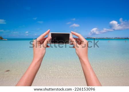 Close up phone background turquoise sea - stock photo