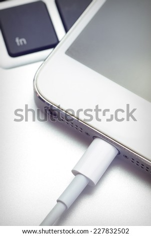 Close - up Phone charging from computer notebook - stock photo