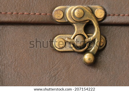 Close up photo of a beautiful graven chest lock  - stock photo