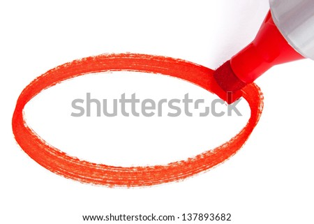 Close-up photo of a big red felt tip marker pen writing an empty circle on white paper - stock photo