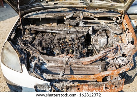 Close up photo of a burned out car - stock photo