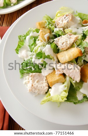 Close up photo of a Caesar salad with chicken - stock photo
