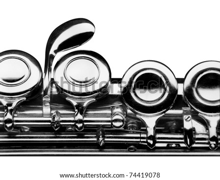 close up photo of a flute over white - stock photo