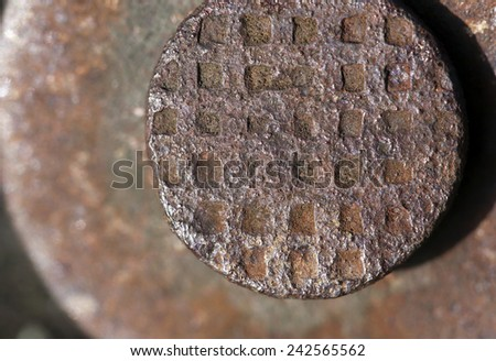 Close up photo of a rusty nail head - stock photo
