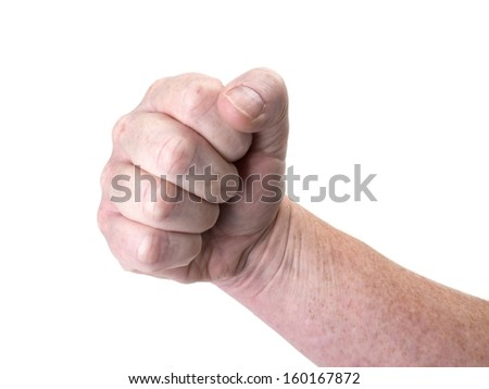Close up photo of a threatening fist isolated on white - stock photo