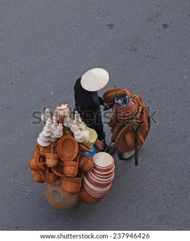 Close up photo of a vendor on street of Hanoi, Vietnam. - stock photo