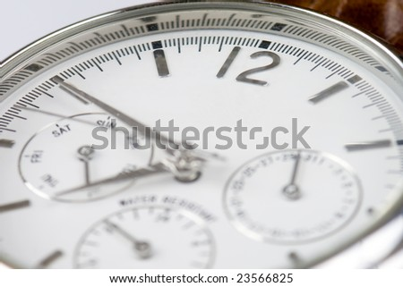 Close-up photo of a wrist watch with copyspace and focus on 12 sign - stock photo