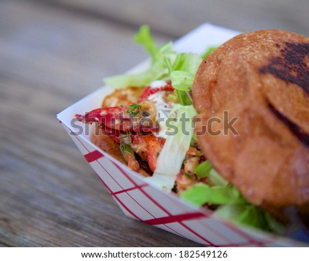 Close-up photo of an appetizing looking burger. - stock photo