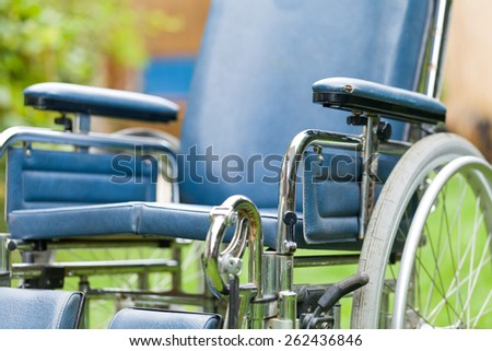 Close up photo of an empty wheelchair  - stock photo