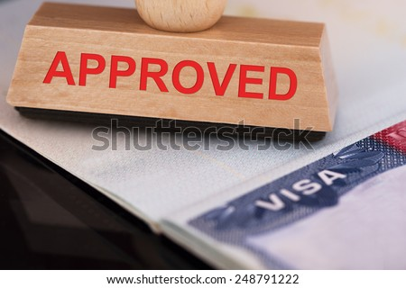 Close-up Photo Of Approved Stamp On Visa - stock photo