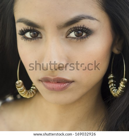Close up photo of beautiful young woman's face - stock photo