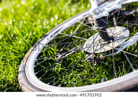 Close up photo of bike wheel on grass
