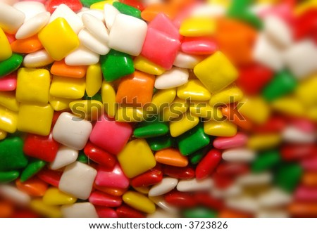 close-up photo of candy gum in vending machine - stock photo