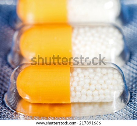 Close up photo of capsules with granules - stock photo