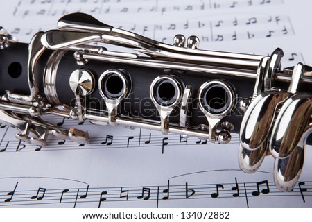 Close-up Photo Of Clarinet And Musical Note - stock photo