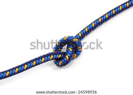 close-up photo of climbing rope tied in a knot - stock photo