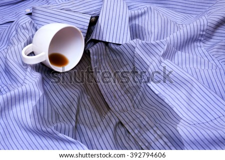 Close up photo of Coffee Spilled On A Shirt - stock photo