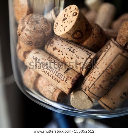 """Close up photo of collection of generic corks from Bordeaux red wine region. text means """"bottled at the estate"""" - stock photo"""
