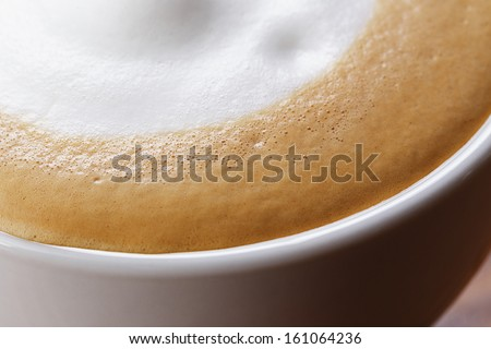 close up photo of dry foam on cappuccino, macro - stock photo