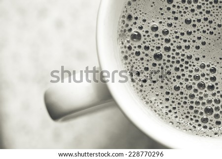close up photo of dry foam on cappuccino, macro top view  - stock photo