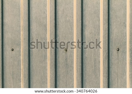 Close up photo of grey metal fence - stock photo