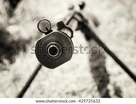 Close up photo of heavy sniper rifle from World War II. Gun scene. Black and white photo. Gun barrel. Armed conflict. Military theme. Portable weapon. Shooting position. - stock photo