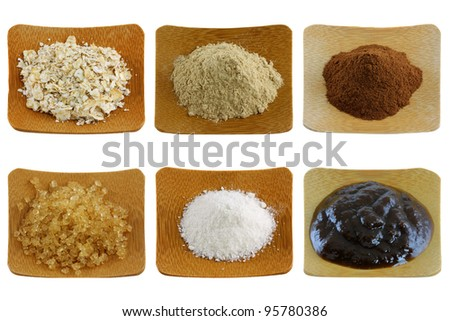 Close up photo of herbal facial mask and body scrub - exfoliating powder on a wooden bowl, isolated on white background - stock photo