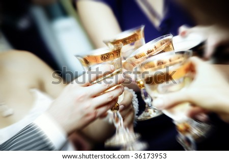 Close-up photo of human hands clangin wineglasses and celebrating event - stock photo