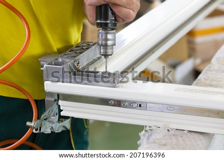 Close up photo of joiner's worker hands doing some job. Selective focus. Shallow DOF. - stock photo