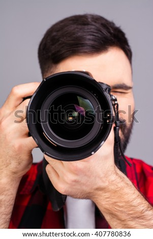 Close up photo of man's hands holding digital camera - stock photo
