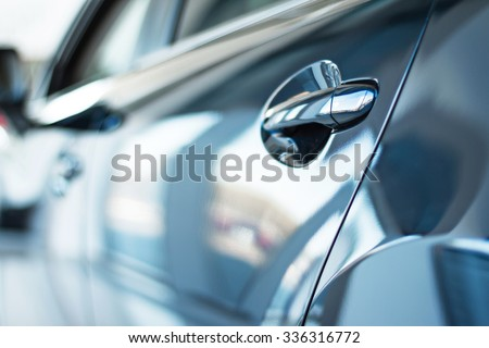 Close up photo of new car door. Concept for car rental - stock photo