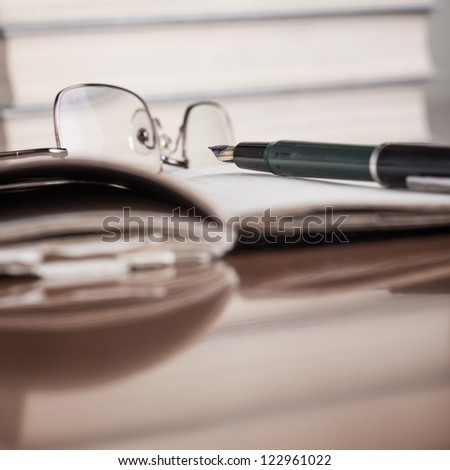 close up photo of notebook and books on table,shallow depth of field