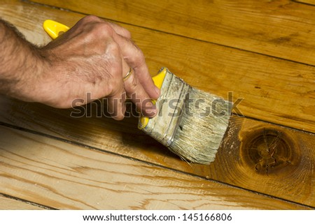 Close up photo of painting the floor - stock photo