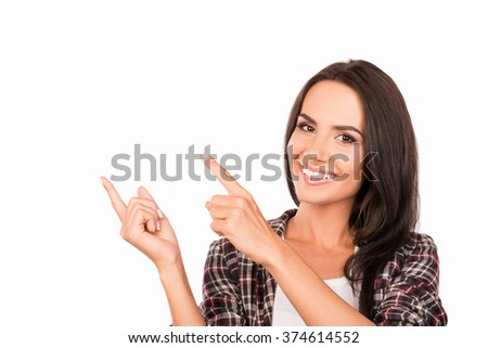Close up photo of smiling attractive girl gesturing with fingers - stock photo