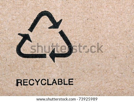Close up photo of the recycle symbol printed on a recycled cardboard box, background - stock photo