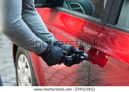 Close-up Photo Of Thief Opening Car's Door - stock photo