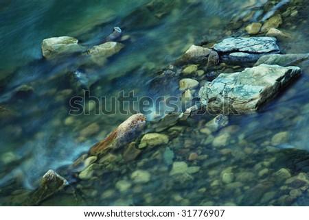 Close-up photo of transparent mountain stream - stock photo
