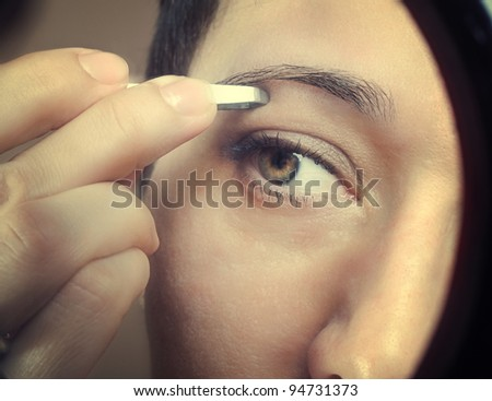 close up photo of tweezing eyebrows