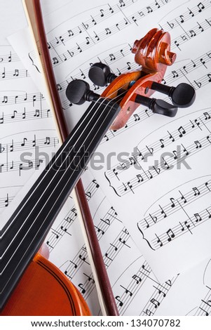 Close-up Photo Of Violin And Musical Notes - stock photo