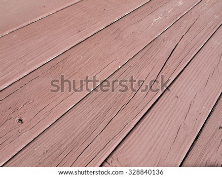 close up photo of  weather beaten painted old wood beams of a deck - stock photo