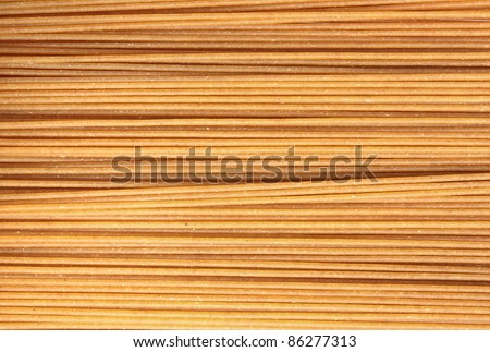 Close up photo of whole wheat spaghetti - stock photo