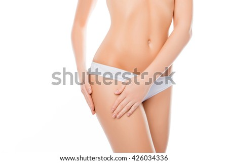 Close up photo of woman in white lingerie touching her hip - stock photo