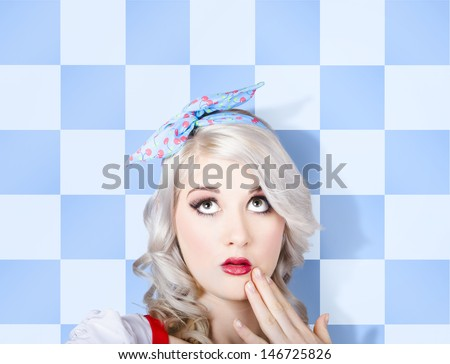 Close-up photo on the surprised face of a young stylish caucasian pinup woman wearing flawless make-up looking up to cosmetic copy space. retro styling - stock photo