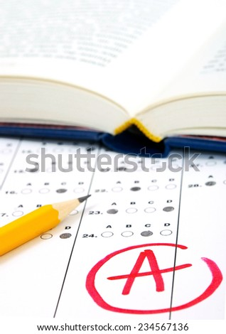 Close-up photograph of a perfect grade on a scantron test. - stock photo