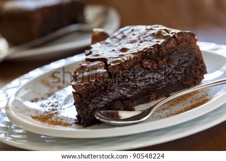 Close up photograph of a slice of chocolate cake - stock photo