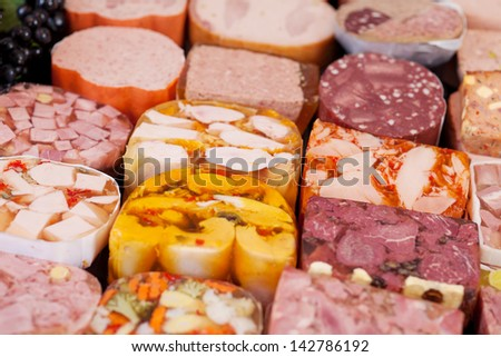 Close-up photograph of the display of varieties of sausages at the sausage counter in a supermarket. - stock photo